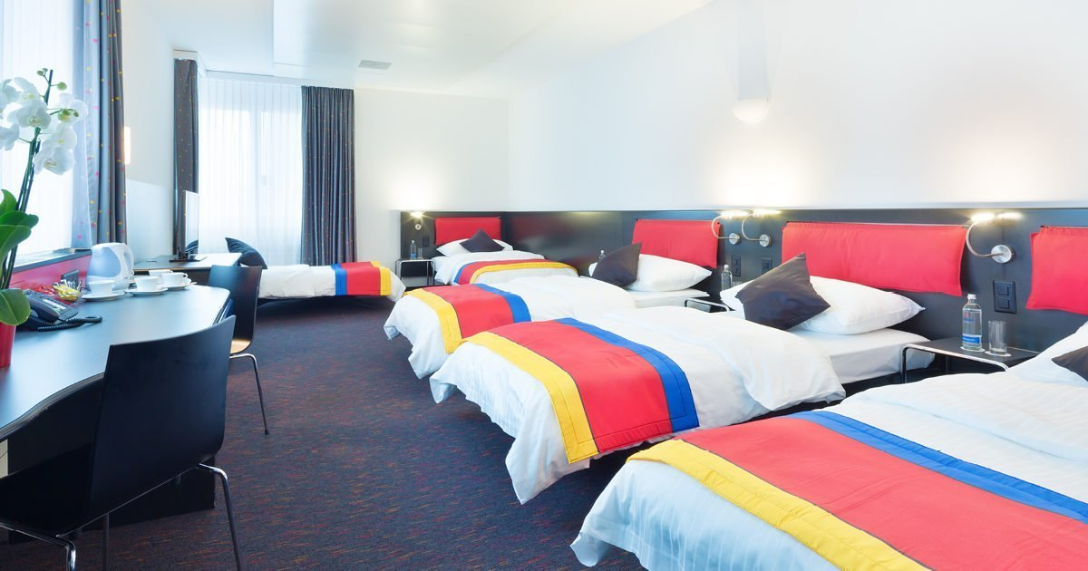 Four bedded Room with Sofa Hotel Allegra, Zurich Airport, welcome hotels